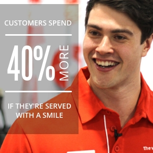 smiling-sales-person-working-in-retail
